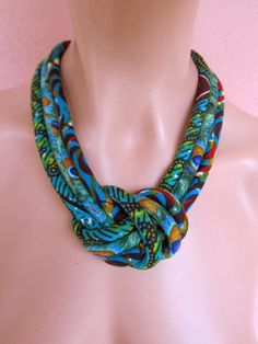 Fabric bib necklace, african wax print with a central knot -turquoise, caribbean green, capri African Earrings, African Jewelry, Fabric Necklace, Knot Necklace, Strand Necklace, Textile Jewelry, Fabric Jewelry, Jewelry Crafts