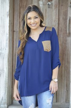 Your day just got ten times better now that you've stumbled upon our Peace Love And Suede Top! This top features slits on the sides and suede on the shoulders!