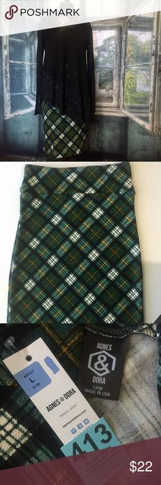 Agnes and Dora plaid pencil skirt 413 Agnes and Dora pencil skirt. I used to be a A&D rep. These skirts have a comfortable yoga waistband. Can be dressed up or down. 97% polyester and 3% spandex. Wash inside out on delicate cycle and hang to dry. Measurements taken flat and in inches. Waist 15. Hip 17. Length 26.  Colors are forest green, white, black, and a thin mustard yellow stripe. Agnes & Dora Skirts Pencil