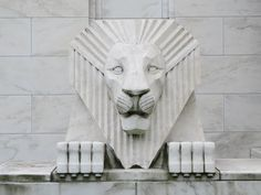 One of two art deco lions which flank the entrance to Iowa Masonic Library and Museum, a building which falls into the category of stripped classical art deco.