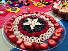 Avenger themed superhero party fruit tray. Strawberry-white choc dipped pretzels, raspberry-blueberry & mini white choc kit Kats