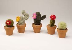 FREE CROCHET CACTI PATTERN (maybe i can beg michelle to make me one these!) ive also seen with wooly yarn, they look like furry cactus
