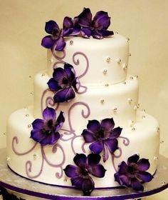 Add in some flowers to match your wedding color theme! Cake via Weddingomania