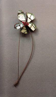 Brooch | Alexander Calder.  Mirror, glass, brass and steel wire.  ca. 1938