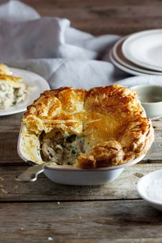 Sometimes all you need is creamy, comforting chicken and mushrooms topped with golden, crisp puff pastry. This easy weekday chicken pie is just the thing to cure this craving. #recipe #chicken #dinner