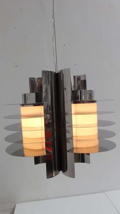 Stunning Stainless Steel Chandelier In Style Of Ico Parisi's 'iride' Series | From a unique collection of antique and modern chandeliers and pendants  at https://www.1stdibs.com/furniture/lighting/chandeliers-pendant-lights/
