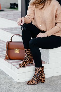 camel sweater, black jeans, leopard booties, brown leather bag, and black sunglasses