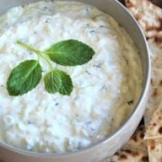 Tzatziki:   1 1/2 cups greek yogurt(plain lowfat) 1 lb english cucumber (persian, peeled and seeded) 3 tbsps extra virgin olive oil 1 tbsp chopped fresh mint (dill) 1 clove garliccloves (crushed or more to taste) 1 tbsp fresh lemon juice (taste) 1/4 tsp salt (taste) 1 sprig fresh mint (garnish optional)