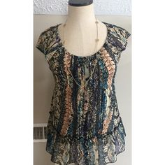 Sheer boho print blouse ties in back sz M by Fire Sheer boho print blouse ties in back sz M by Fire Los Angeles. Has lace details and a very small run in the sheer material near the neckline. Shown in 3rd pic- but you probably won't even see it in the pic Fire Los Angeles Tops Blouses