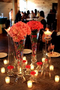 Stunning centerpiece of pink hydrangea, pink nareens and gerbera daisies. Having centerpieces at different levels makes it more interesting on the eyes.    Photo: Al Cooley Photography