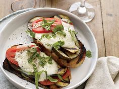 Open-Face Grilled Eggplant Sandwiches | Pairing note For this smoky version of eggplant Parmesan, Sam Calagione and Marnie Old looked for a beer and a wine that could stand up to the grilled...