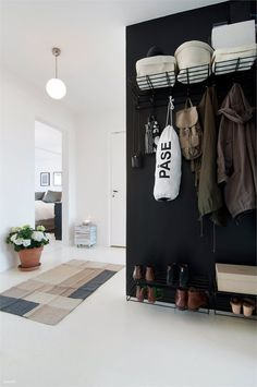 Discover more of the best Interiors, Anthracite, Storage, and Hallway inspiration on Designspiration House Design, Interior, Hallway Inspiration, Entry Hallway, Home Decor, House Interior, Black Walls, Entryway, Interior Design