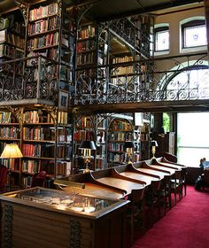 """Andrew Dickson White Library, Cornell University. """"...this intimate space makes a dramatic impression with three tiers of wrought-iron stacks. Andrew Dickson White was the university's co-founder and first president, and he donated his diverse 30,000-book collection, which included volumes on everything from architecture and witchcraft to the French Revolution and Civil War. The room also displays art, artifacts, and furniture from White's diplomatic career stationed in Germany and...Russia."""""""