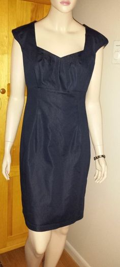 Connected Apparal  black wiggle dress size 12 lined with leopard