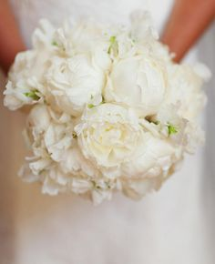 Bouquet of White Peonies | 9 Summery Hamptons-Inspired Wedding Details | https://www.theknot.com/content/8-summery-hamptons-inspired-wedding-details