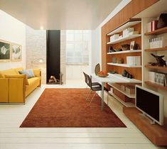 How cool is this? A living room where the couch converts to bunkbeds...and the bookshelves/desk convert to a full bed!! Talk about a studio apartment actually working for a family!!