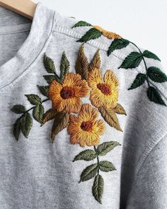 Leafy, floral, upcycled goodness 🌿 Embroidery On Clothes, Shirt Embroidery, Hand Embroidery Patterns, Embroidery Designs, Sewing Patterns, Flower Embroidery, Embroidered Caps, Embroidered Sweatshirts, Embroidered Clothes
