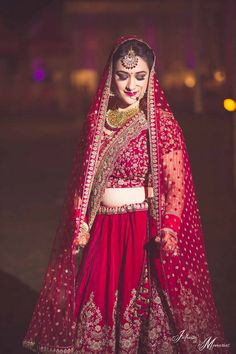 Looking for Bride posing in deep red bridal lehenga with threadwork? Browse of latest bridal photos, lehenga & jewelry designs, decor ideas, etc. on WedMeGood Gallery. Wedding Lehnga, Indian Bridal Lehenga, Indian Bridal Outfits, Indian Bridal Fashion, Indian Bridal Wear, Bridal Dresses, Indian Wear, Wedding Bride, Bridal Sarees