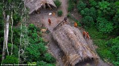 Members of an uncontacted tribe in the Brazilian state of Acre, as seen from satellite ima...