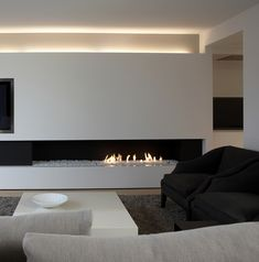 sleek fireplace, with additional design elements, so the fire doesn't need to be on. Estilo Interior, Modern Interior, Interior Architecture, Home Fireplace, Fireplace Design, Fireplace Lighting, Linear Fireplace, Design Case, Home And Living
