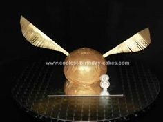 Homemade Golden Snitch Birthday Cake: My son wanted a Golden Snitch Birthday Cake for his birthday and I wasn't sure how to approach it. I made a round cake using Wilton soccer tin. I made
