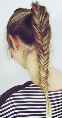 High fishtail braid... I'm going to have to grow my hair for another 17 years to do this, but a girl can pin...
