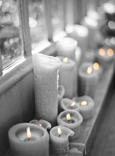 Lit candles on pastel green window sill (great Christmas idea) Candle Lanterns, Pillar Candles, Grey Candles, Beeswax Candles, Wabi Sabi, Stone Fox Bride, Candle In The Wind, Once Wed, Décor Boho