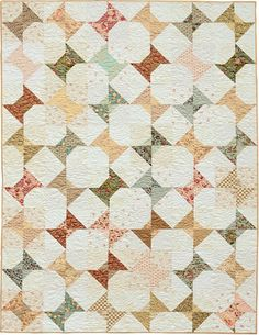 Pretty Patchwork Quilts.  So simply, yet stunning!  Snowball blocks with small corner triangles alternate with snowballs with large corner triangles!