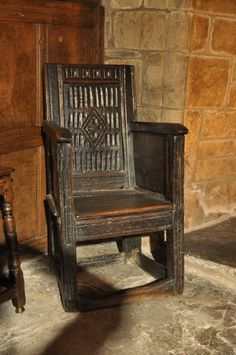 A WONDERFUL AND EXTREMELY RARE TUDOR CARVED OAK ARMCHAIR. ENGLISH. CIRCA 1540.