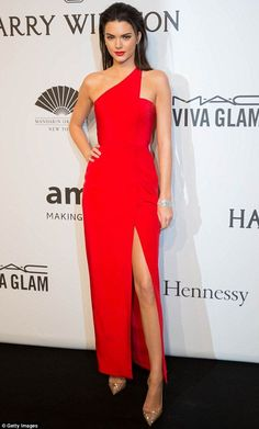 Painting the town red! Kendall Jenner looks runway ready in thigh-high split gown at amfAR Gala in New York on Wednesday