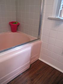 The Painted Home: { Smoke & Mirrors - A Bathroom Reveal }.   Not only do I have a BA with mauve/pink tile, I have one with blue tile and tub. I feel a project coming on!