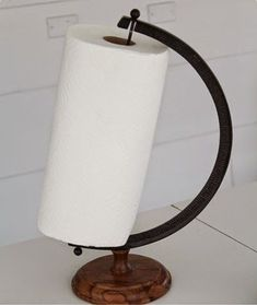 Repurposed world globe stand into kitchen paper towel holder