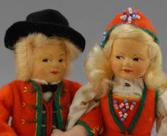 """Close up of 8"""" pair of stuffed cloth dolls in regional ethnic dress, with painted pressed felt faces, Norway, 1965-70, by Rønnaug Petterssen."""