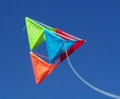 Flying Tetrahedral Kite. Making this kite! Totally making this kite. And all I need is straws, tissue paper, kitchen string or kite string, and some glue!