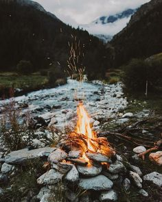 camp. fire. mountains. river. woods. river stones. pnw
