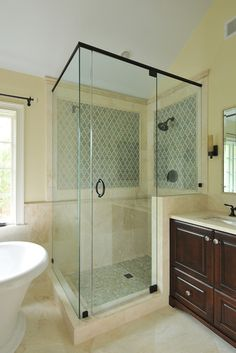 Walker Zanger handmade ceramic blue tile, travertine on floor and wainscot, Traditions in Tile limestone trim pieces. Also the key to a beautiful tile install is to lay out the entire bathroom each wall and floor individually and measure a bunch of times then discuss all of this over and over with your tile installer!! and get the best installer you can find!!