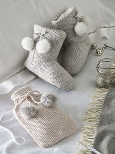 Wrap up warm this winter with our loungewear collection. A great stocking filler, these pom-pom slipper boots are knitted in brushed grey and white yarns. Keeping toes, ankles and legs cosy, they are lined in soft faux fur and have a soft, flexible outsole for squidgy comfort. We've finished them with two fluffy pom-poms on the side. Thoughtful Gifts For Her, Special Gifts For Her, Presents For Her, Perfect Gift For Her, Creative Gifts, Unique Gifts, Best Gifts, Pom Pom Slippers, Cosy Winter