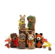 """Wee Woodland Wuzzies by Barbara Prime - This pattern is available for $3.99 USD. The pattern includes instructions for 6 animals: squirrel, mouse, hare, otter, hedgehog, and fox. The finished toys are approx. 3"""" tall, and use only a small amount of worsted yarn for each animal. The hat and scarf patterns are also included, and they use small amounts of fingering or sport weight yarn."""