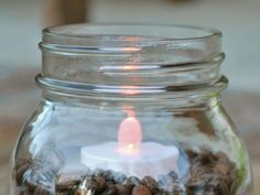 Coffee Bean Candle Centerpieces - on HGTV - could but a filler in with beans all around it - would go with wood element on tables