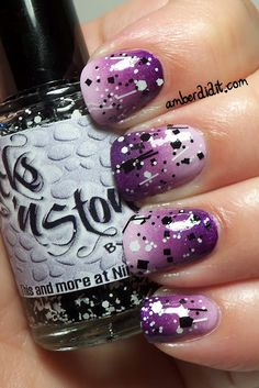 Purple black and white nails.