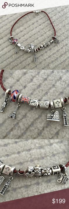 Pandora 100% authentic 15 charms n bracelet This is sa great deal it's a pandora charm bracelet 15 charms we have statue of Liberty Eiffel tower coliseum Rome Big Ben London and double decker London bus suit case bible dolphin queen bee carriage the letter J and a best friend butterfly and glass red white blue bead on a red leather bracelet some charms retired also a sterling silver golden gate bridge charm that charm is not Pandora but the rest is 100% authentic Pandora Jewelry Bracelets