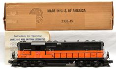 Lionel postwar 2338 Milwaukee Road GP-7  diesel, harder to find version with solid orange band around shell with instruction sheet in OB.  The diesel has some minor box rubs, otherwise is C8.  The box is correctly stamped 2338X and is complete with all flaps.