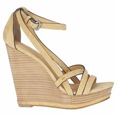 Wearing a wedge heel under your wide leg jeans will be the most flattering. They will work with the jeans to slim and elongate your figure. The heels don't have to be wedges but they are more comfortable when adding such height. They come in the strappy for summer or more like a shoe for colder months.