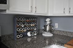Love the white cabinets, wall color and counter tops together!