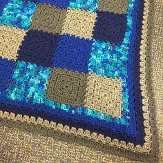 My version of http://thecrochetcrowd.com/crochet-modern-baby-granny-blanket-pattern/