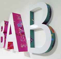 this would be fun to try... you can buy wooden letters that are plain at the craft store, if everyone purchased their own letters we could get together and share supplies to decorate our letters. We could use paint, contact paper, markers, stickers, we could glue on stuff and much much more!!