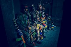 South African filmmaker and artist Ralph Ziman, in his series Ghosts, created AK-47s out of beads, and placed them in the handles of Zimbabwean street vendors. Having no direction on how to hold th...