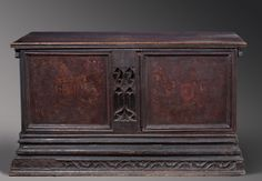 Gothic Marriage Chest - Oak chest with detailed carving and painted scenes. The faint traces of family coats of arms can be seen on the front, with a beautiful angel holding a fish on the inside lid - Catalonia, Spain - late 15th century - Closed Front View