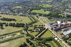 Perfect for a lovely summer day like today! Hampton Court Palace! #aerialphotography #HamptonCourtPalace #London #summer #grounds #trees #palace #River