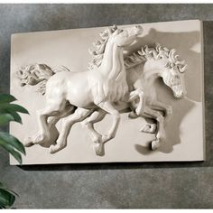 """Artists have been inspired by the sheer beauty and raw strength of wild horses since the days of the Parthenon, two wild and unbridled steeds virtually leap from this high-relief wall frieze. 18""""W x 4½""""D x 12½""""H Sculpture Garden Statue, Sculpture Greek Statue, Sculpture Bronze Statue, Sculpture Angel Statue, Sculpture Religious Statue, Sculpture Horse Statue, Sculpture Eagle Statue, Sculpture Egyptian Statue, Sculpture Catholic Statue, Sculpture Lion Statue, Sculpture Nude S..."""